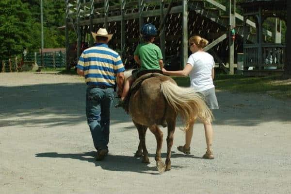 horses ridin hy ranch