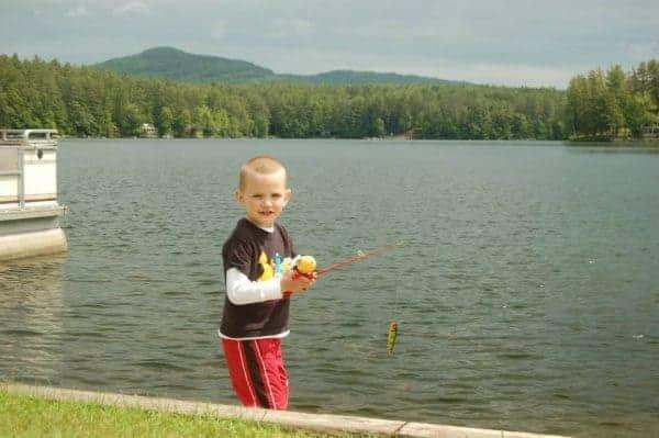 little boy fishing ridin hy