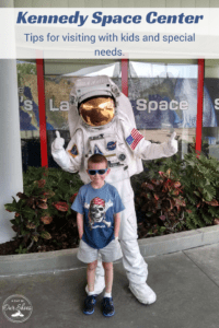 kennedy space center someone dressed as an astronaut and a little boy smiling having his picture taken