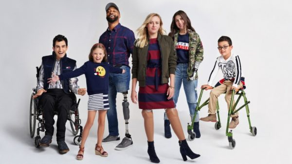 several kids and adults wearing adaptive accessible clothing for special needs