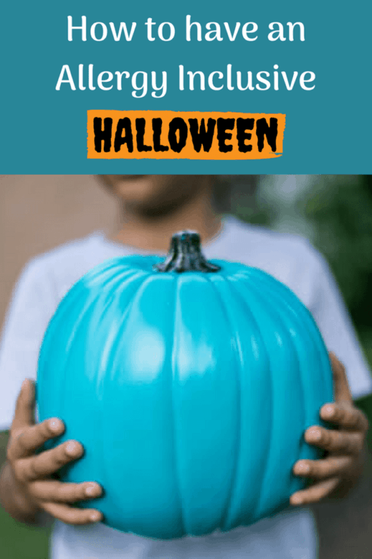 allergy inclusive halloween child holding a teal pumpkin