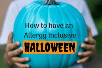 allergy inclusive halloween child holding a teal pumpkin