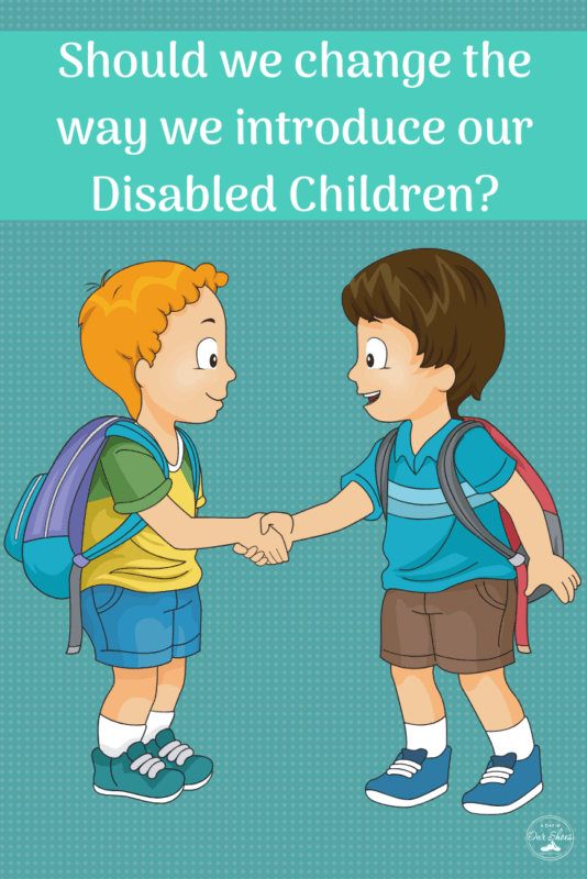 should we change how we introduce out disabled children two little boys shaking each others hand