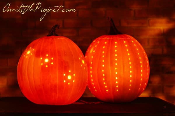 2 pumpkins decorated with a drill