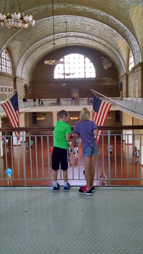 two kids inside the building at ellis island