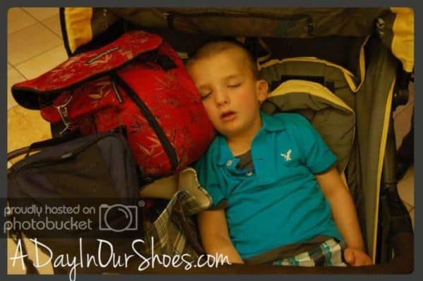 young boy asleep in blue shirt