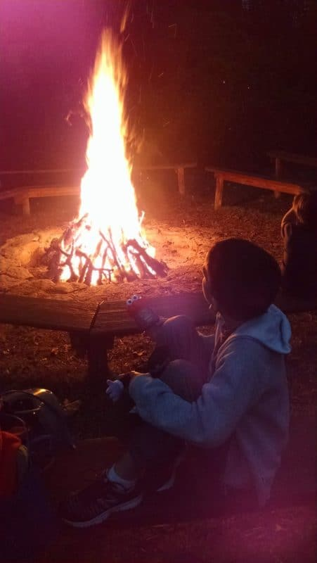 Kevin enjoying a bonfire at Milburn Orchards.