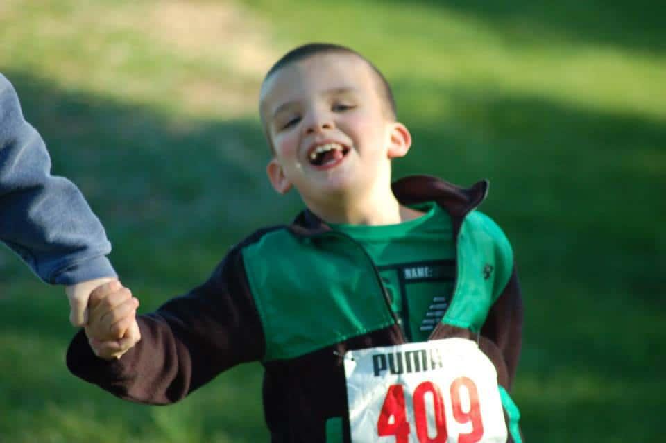 Kevin running boy wearing a marathon number running