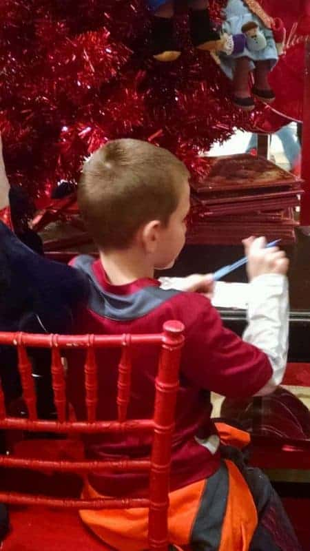 brian writing a letter to santa at Macy's