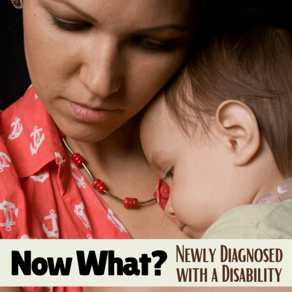 a mom comforting her child who is newly diagnosed with a disability