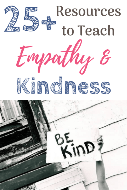 teach empathy and kindness holding up a sign that reads be kind
