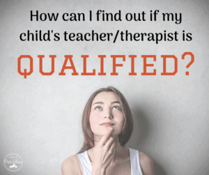 is my childs teacher and therapist qualified woman with hand on chin thinking and pondering