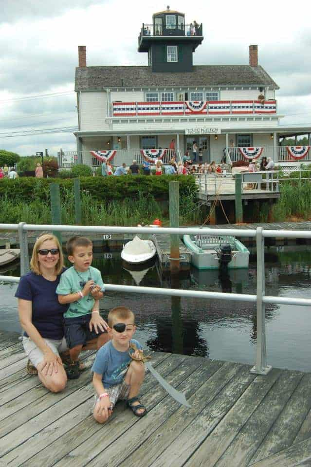 tuckerton seaport lighthouse mom and boys taking photo in front of the lighthouse